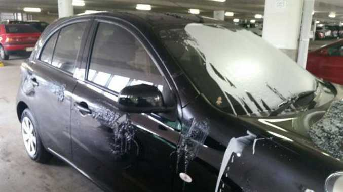 : SCN171114PAINT Cpation: A Noosa woman returned to her car after shopping for 45 minutes to find it had been wiped with paint thinners and paint poured over the windscreen.