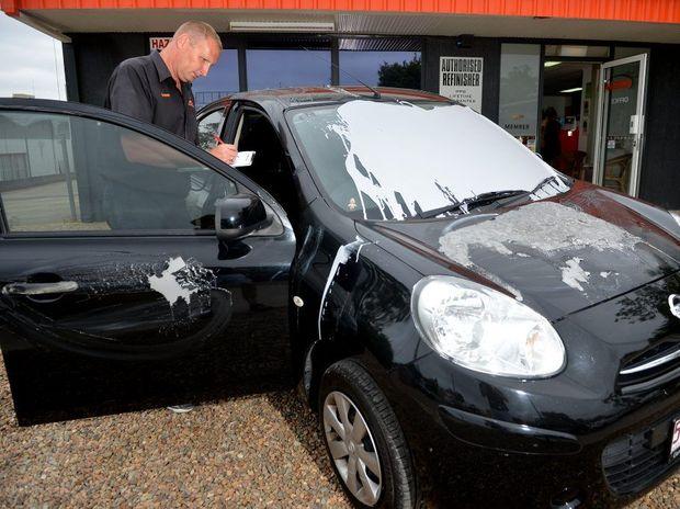 Director of Omega Auto Body Repairs , Darren Kopinski, surveys the vandalism to a vehicle. Photo: Warren Lynam / Sunshine Coast Daily