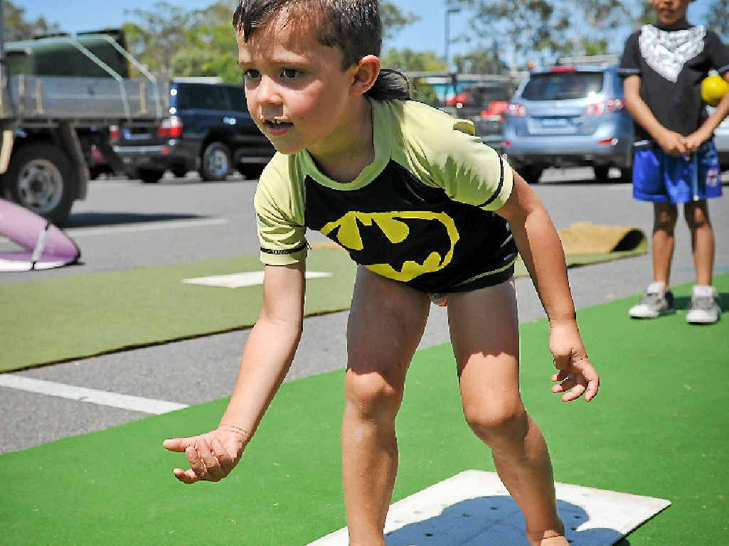 ON A ROLL: Campbell Hansson, 4, a future Australian bowler, practising outside Bunnings on Saturday.