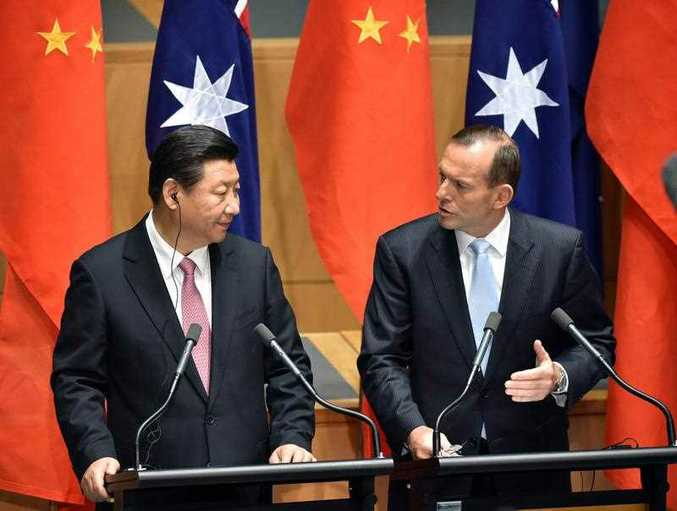 China's President Xi Jinping (L) and Australia's Prime Minister Tony Abbott (R) make statements to the media following the signing of a free trade agreement at Parliament House in Canberra on November 17, 2014. Xi is visiting Canberra after attending the G20 Summit in Brisbane over the weekend.