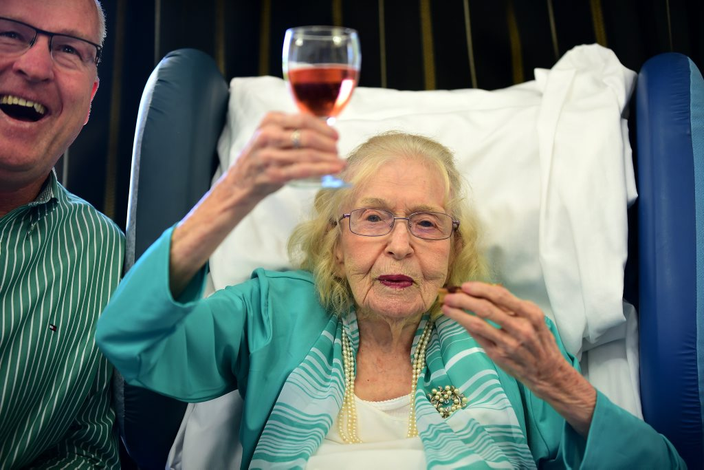 Monica Guy turned 108 surrounded by family and friends. Mayor, Mark Jamieson shares a cheers and a laugh with Monica. Photo: Cade Mooney / Sunshine Coast Daily