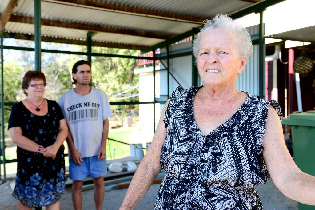 Hilda Salter, pictured with her daughter Diane Carolan and son Craig Salter, inside the unfinished carport - after waiting for the builder to finish the job started in February. Photo Sharyn O'Neill / The Morning Bulletin
