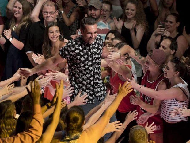 Big Brother evictee David Hodis greets fans at Dreamworld.