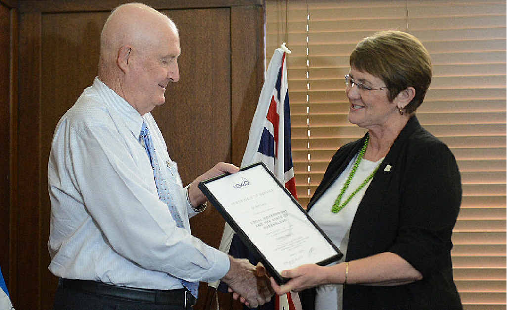 RECOGNITION: Local government leader Margaret de Wit acknowledges Gympie region Mayor Ron Dyne's 15 years of service to local government. PHOTO: CRAIG WARHURST