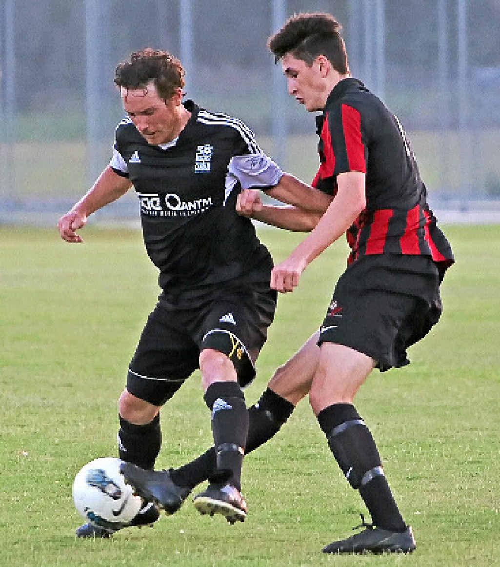 DEFENSE: Byron mentor Ben Ahern keeps the Villa boys at bay.