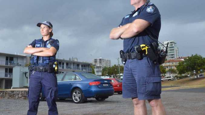 CRACK DOWN: Police constables Steph Wolff and Mark Jackson stand watch in the car park at Kings Beach where three teens were caught hooning.