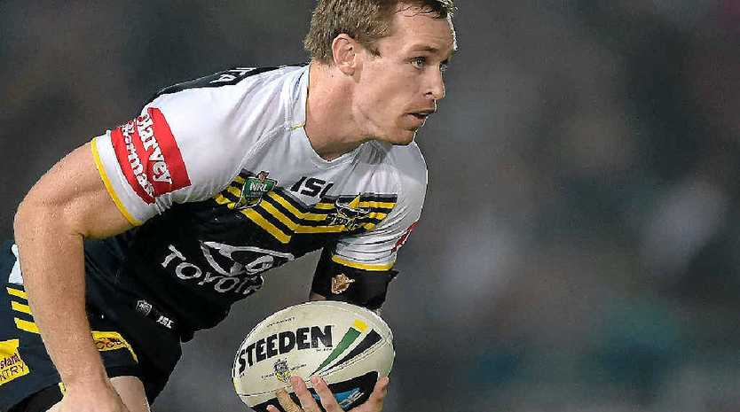 NO.1 GIG: Michael Morgan in action for the Cowboys last season, and Lachlan Coote, in training with the Cowboys, will battle it out for the fullback position.