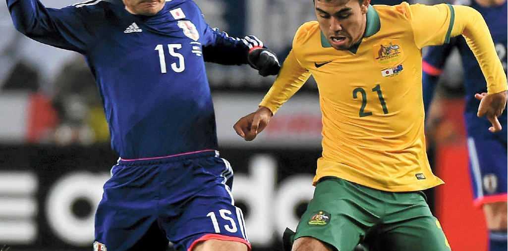 PROMISING FUTURE: Massimo Luongo tussles with Yasuyuki Konno of Japan at Nagai Stadium.