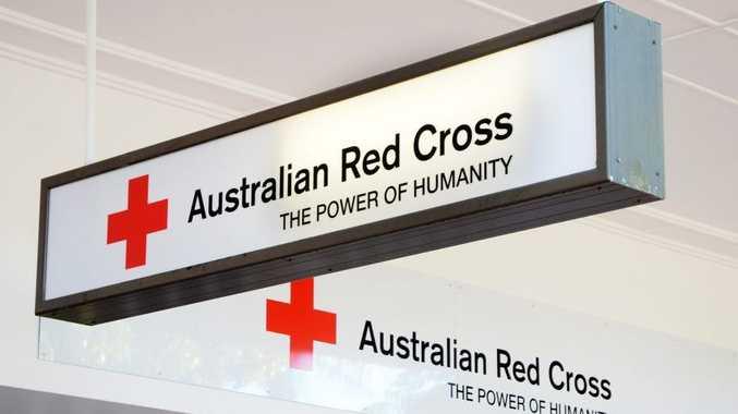 Volunteers filling the new Red Cross Op Shop in Harbour Drive.