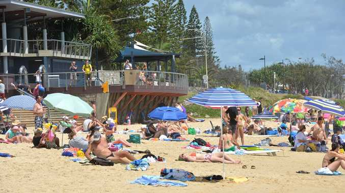 Plenty of sun on a busy day Mooloolaba Beach.