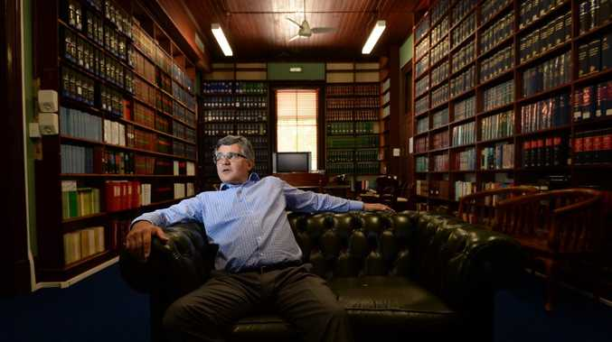 Barrister Ross Lo Marco in the old Supreme Court building library. Photo: Chris Ison / The Morning Bulletin