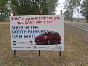 Negative shopping campaign signs cause controversy