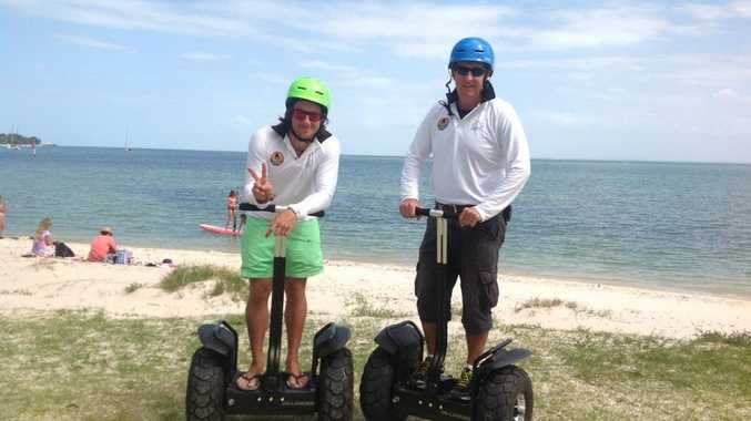 Simon and Paul Mansbridge show off some segways on offer for hire at Bribie Island Hire Hut and Tours. Photo Contributed.