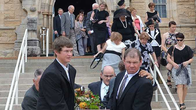SAD DAY: Fabian Webb's grandson and son lead the pall bearers as his casket is taken from St Patrick's Catholic Church yesterday.