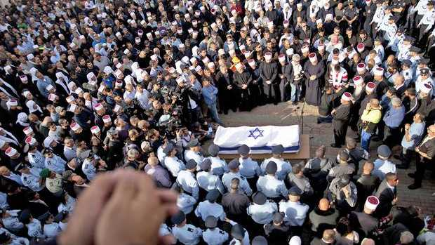 Mourners attend the funeral of a policeman killed in the synagogue attack in Jerusalem. Photo: GETTY