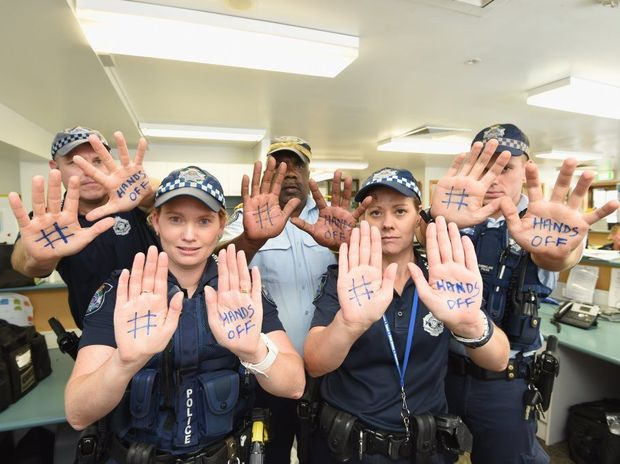 Hervey Bay police officers Senior Constable Mick Bleakley, Constable Sarah Green, Police Liaison Officer Goomblar Shillingsworth, Constable Leigh Nancarrow and Constable Pete Smith support the Chronicle's #HandsOff campaign.