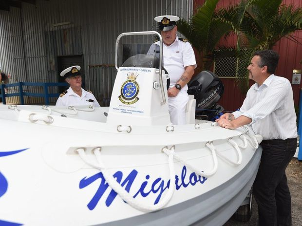 Taking a look at TS Krait's Rigid Hull Inflatable Boat are Lt Dennis Uren (Daring Flotilla), Acting Commanding Officer TS Krait Sub Lt Peter Green and Parliamentary Secretary to the Minister of Defence Darren Chester.