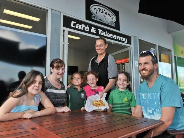 Haylee McDonald, 10, Kylee McDonald, Tyler Milani, 6, Caitlyn McDonald, 6, Jo Wilson, Maddison McDonald, 6, and Hayden McDonald at Milani's Cafe and Takeaway.