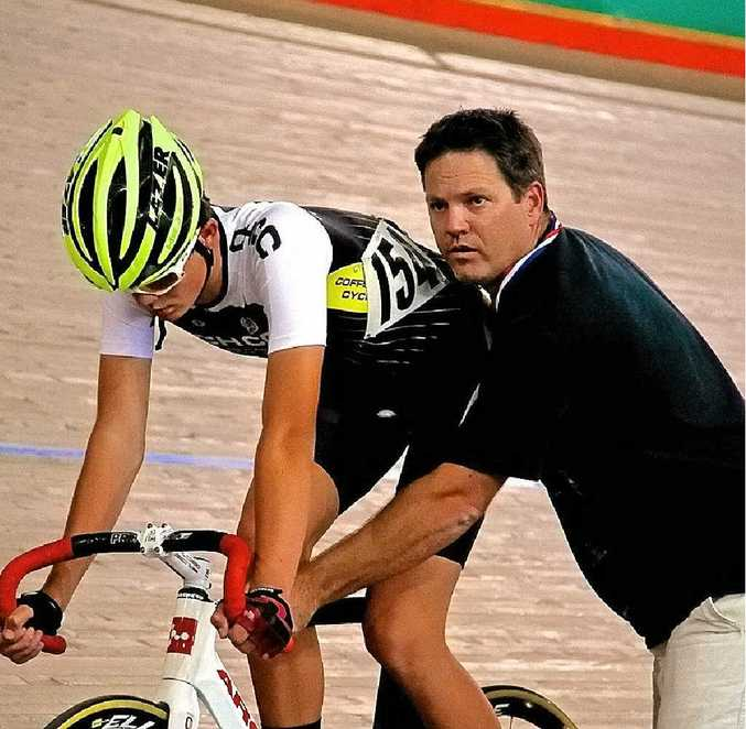 Shaun Cameron receives assistance from dad, Craig, while preparing for his event at Dunc Gray Velodrome.