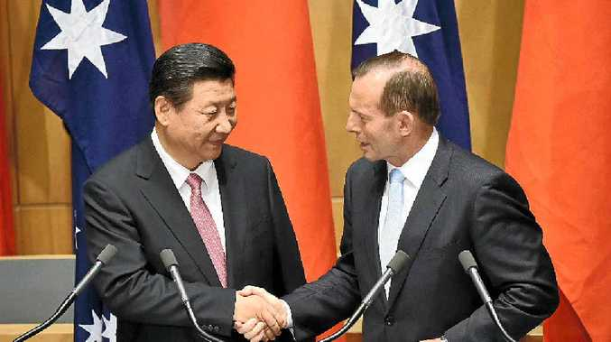 BIG NEWS: China's President Xi Jinping shakes hands with Australia's Prime Minister Tony Abbott after statements to the media following the signing of a free trade agreement at Parliament House on Monday. The trade deal is big news for Gympie region's macadamia industry.
