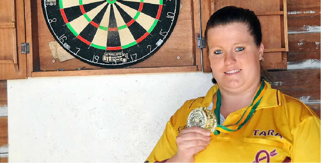 SHARP SHOOTER: Tara Rowe with the two medals she won at the under-25 national darts champs.