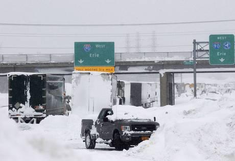 Vehicles litter the highway in West Seneca, New York