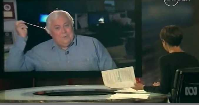 Sunshine Coast MP Clive Palmer pulls out his earpiece after refusing to answer questions on ABC's Lateline program on Thursday night. Source: ABC