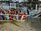 Formal-bound teens collapse bridge during photo shoot
