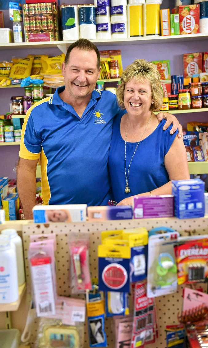 KEEP EVOLVING: Mike and Jenny Parsons from Mudjimba News community store are a small business success story but the hours are long.