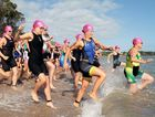 Hervey Bay 100- Triathletes hit the water for the first leg of the triathlon.