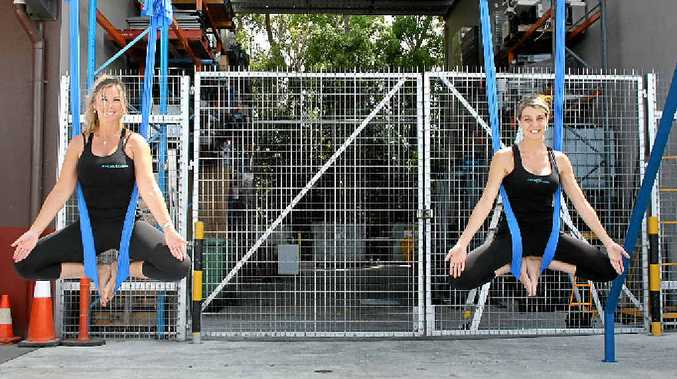 WELLBEING: Stacy Downey and Janice Roy prepare for their Aerial Pilates display at Kunara Organic Marketplace.
