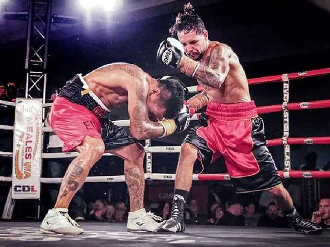UNANIMOUS DECISION: Paul Fleming gets the upper hand in his fight against Angky Angkotta in Perth.