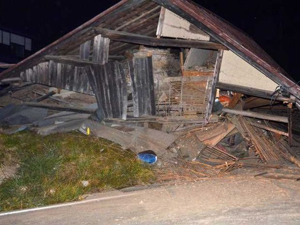 A house is collapsed after a strong earthquake hit in Hakuba, Nagano Prefecture, central Japan, Saturday, Nov. 22, 2014. The magnitude-6.8 earthquake struck the mountainous area of central Japan Saturday night, causing at least one building to collapse and injuring several people, according to Japanese media reports. No tsunami warning was issued.