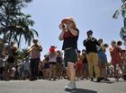 Harry Angus, known from Cat Empire, leads the street parade down the main drag of Mullumbimby to the Civic Hall as part of festivities for the Mullumb Music Festival.