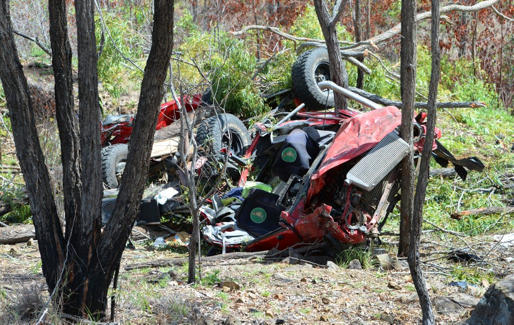 Wrecked car off the Burnett Highway at Struck Oil after it left the road and rolled down an embankment. Photo: Chris Ison / The Morning Bulletin