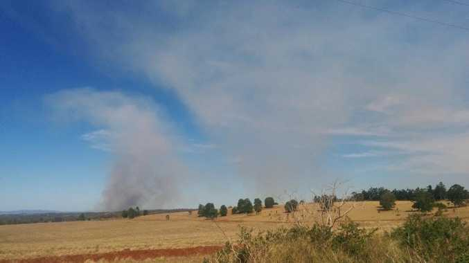 QFES crews are fighting a grass fire in Teelah.