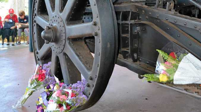 MEMORIAL: Wreaths laid at the base of the big gun.