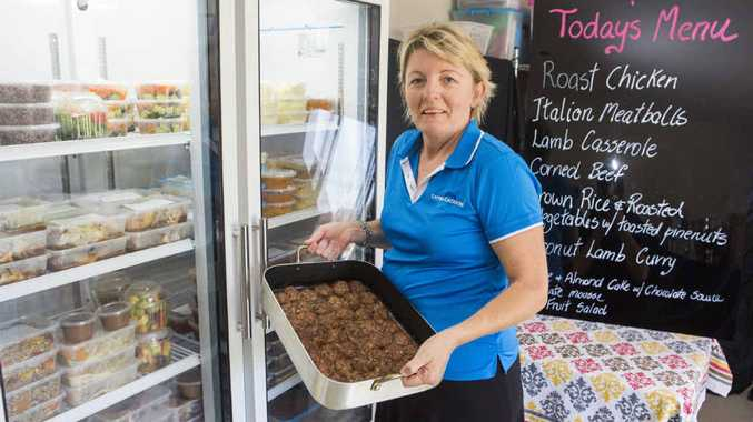 DISING IT UP: Lauren Argent of Yamba Catering with some of her meals. Photo: Adam Hourigan
