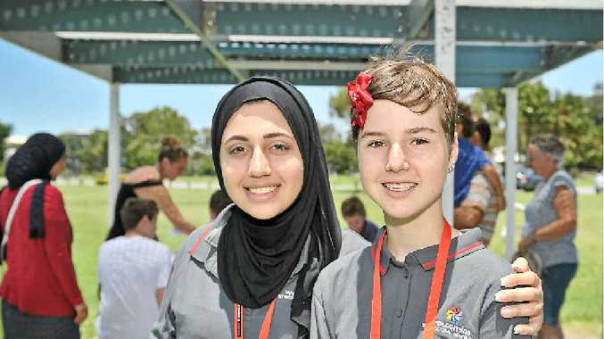 BRINGING YOUTH TOGETHER: Organisers Diyar Hafedf, 18, and Jasmine Elliot, 13, at the first Gladstone Youth for Cultural Diversity event on Saturday.