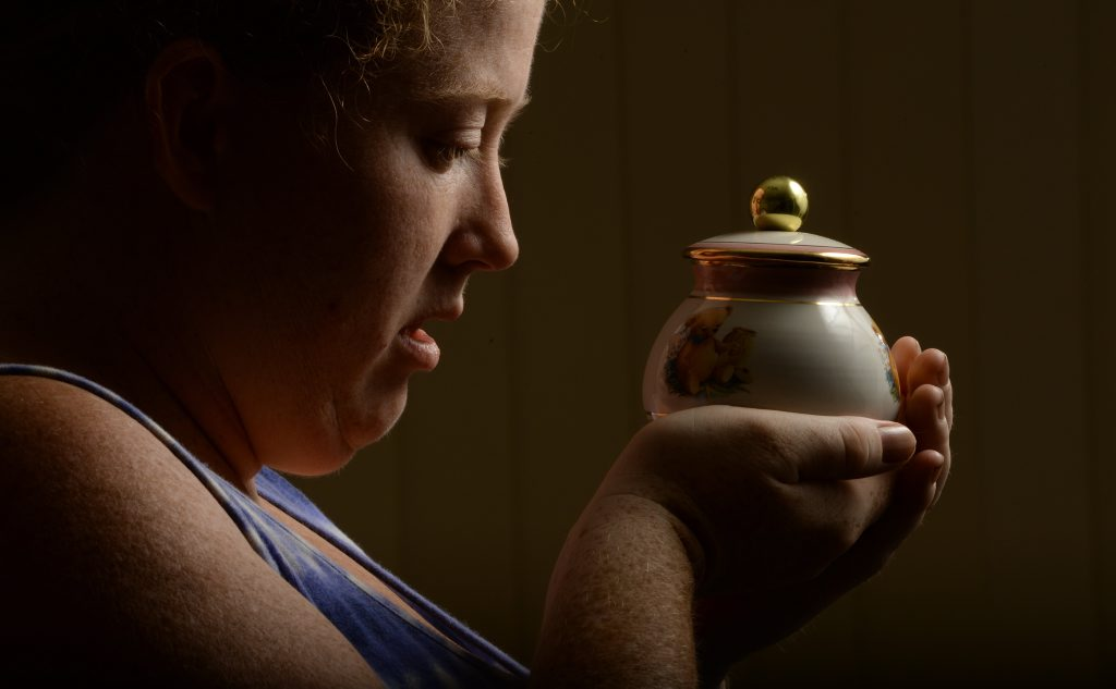 Rachelle Lind with the ashes of her daughter Caitlin who passed away after complications. A coroner's report into the death of the baby raises serious questions on the conduct of the staff at Ipswich Hospital.