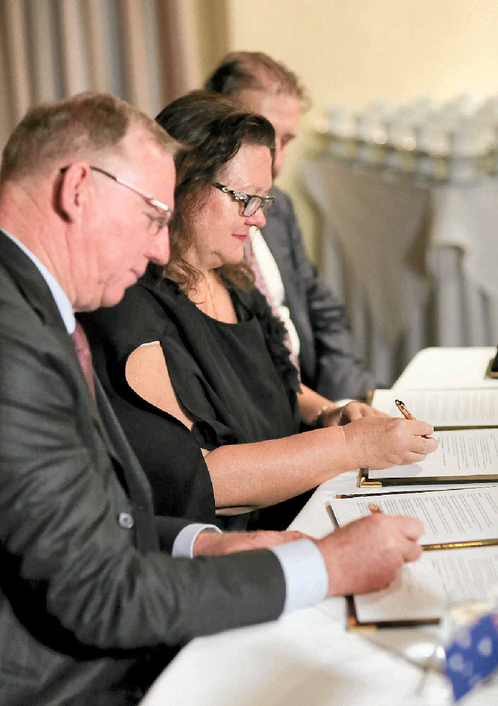 MAJOR INVESTMENT: Gina Rinehart and Deputy Premier Jeff Seeney sign the Memorandum of Understanding for the $500 million deal for Gympie and the South Burnett's dairy project.