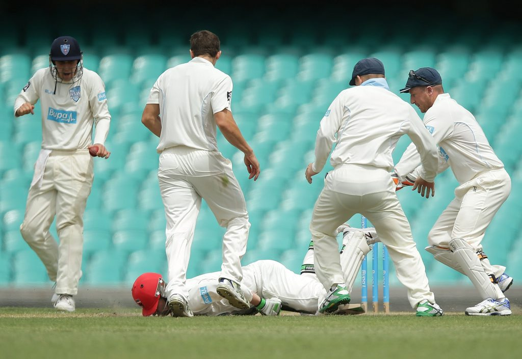 Phillip Hughes falls to the ground after being struck in the head by a delivery during day one of the Sheffield Shield at the Sydney Cricket Ground.