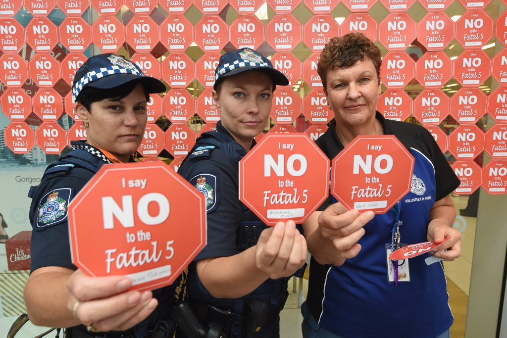 Senior Constable Mel Ryan, Senior Constable Melissa Watherston and volunteer in policing Jill Barclay with pledges that can be signed during the Fatal Five awareness campaign at Stockland Hervey Bay.