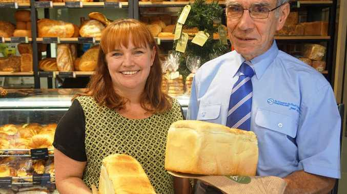 BREAD FOR THE NEEDY: Brumby's general manager Shonnea Nicol with John Forrest of St Vincent De Paul.