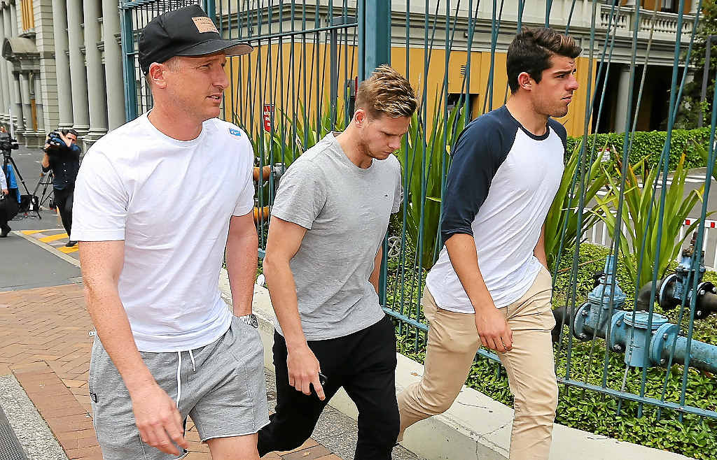 SHOWING SUPPORT: Brad Haddin, Steve Smith and Moises Henriques outside St Vincent's Hospital in Sydney, where Phil Hughes has been since being hit by a bouncer on Tuesday.
