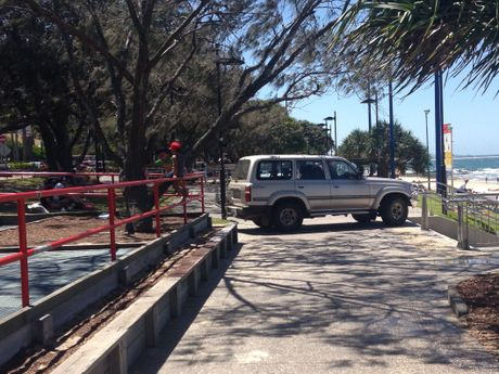 WHOOPS: Driver tries to turn around after finding himself stuck on a footpath at Mooloolaba.