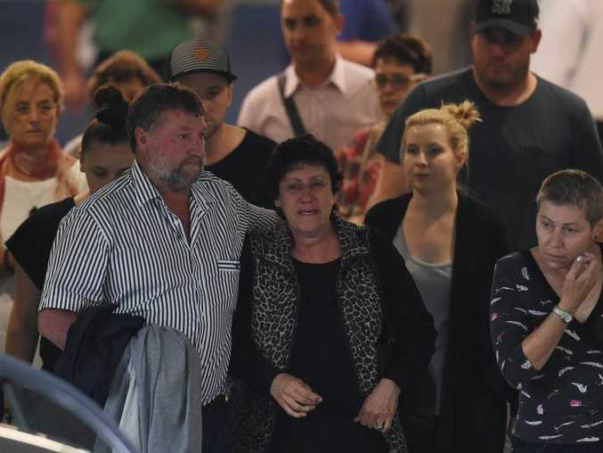 The parents of Phillip Hughes, father Greg and mother Virginia and family members leave St. Vincents Hospital in Sydney.  (AAP Image/Dean Lewins)