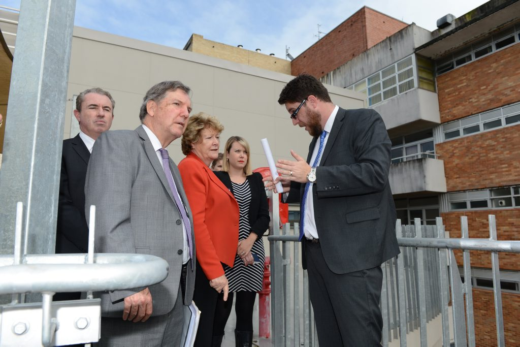 Northern NSW Local Health District chief executive Chris Crawford (in grey suit at front) pictured during a tour of Lismore Base Hospital with NSW Health Minister Jillian Skinner.