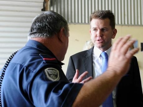A Maryborough Correctional Centre officer gives Queensland's Attorney General Jarrod Bleijie a run-down of one of the workshops in the facility.