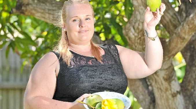 MANGO MANIA: Kirsty Webb is welcoming residents into her backyard this summer to pick mangoes from her two trees.